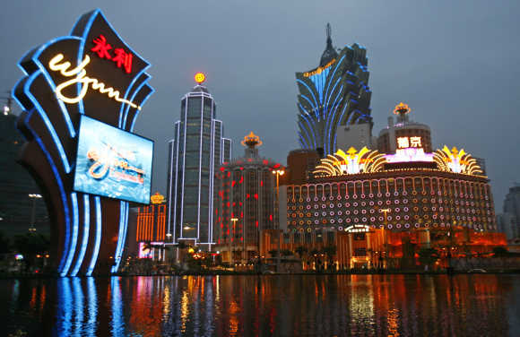 An evening view of Wynn Macau Casino, Casino Lisboa and Grand Lisboa Casino in Macau.