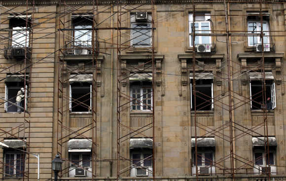 A labourer carries out renovation work on a commercial building in Mumbai. Photo is for representation purpose only.