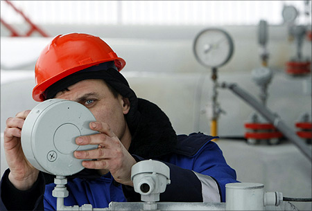 A Gazprom technician works on a pressure gauge at the gas export monopoly's Sudzha compressor station.
