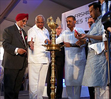 Union Agriculture Minister Sharad Pawar with Heavy Industries Minister Praful Patel and Deputy Chief Minister Ajit Pawar at the inauguration of the Vespa plant at Baramati.
