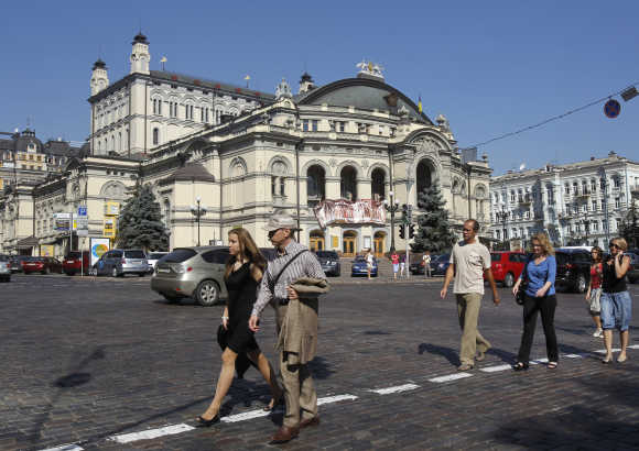 People walk in front Kiev's Opera in downtown Kiev.