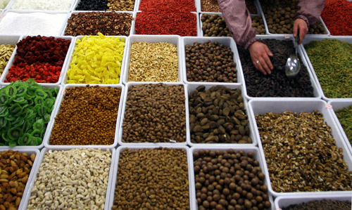 A vendor sells dry fruits and nuts at a market in Lanzhou, northwest China's Gansu province.