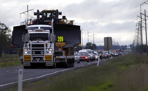 Highway traffic is backed up behind a piece of heavy mining equipment as it rolls though Dalby, 180 km (112 miles) west of Brisbane.