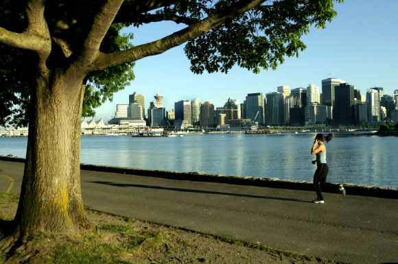 A jogger runs along the seawall in Stanley Park in Vancouver.
