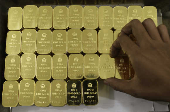 Gold piece, each weighing 100 grams, are seen at a mining company in Jakarta, Indonesia.