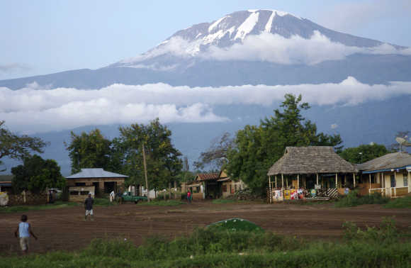 Houses are seen at the foot of Mount Kilimanjaro in Tanzania's Hie district.