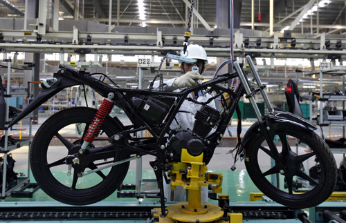 An employee works at an assembly line of Twister motorcycle at the newly inaugurated plant of Honda Motorcycle and Scooter India (HMSI) Pte in Tapukara in Rajasthan.