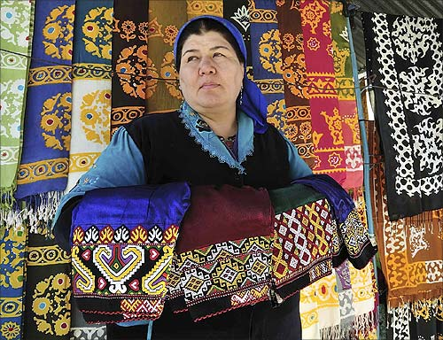 A woman looks out from her stall selling traditional garments and textiles at a market in the Turkmen capital Ashgabat.