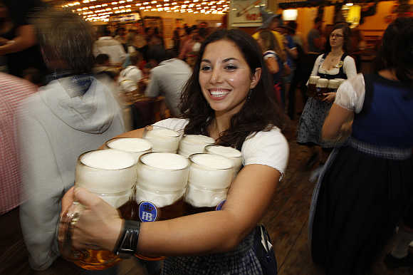A waitress serves beer at the Oktoberfest in Munich.