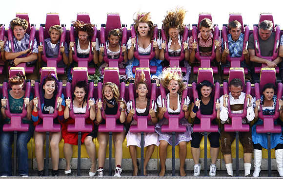 Revellers enjoy a ride in a roller coaster in Munich.