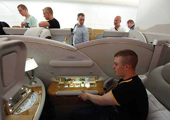 Visitors inspect the interior in First-Class section on board Airbus A380 passenger plane of Emirates Airline at ILA International Air Show in Schoenefeld outside Berlin, Germany.