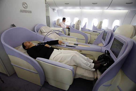 A woman checks out a First-Class seat of the Airbus A380 superjumbo in Shanghai.