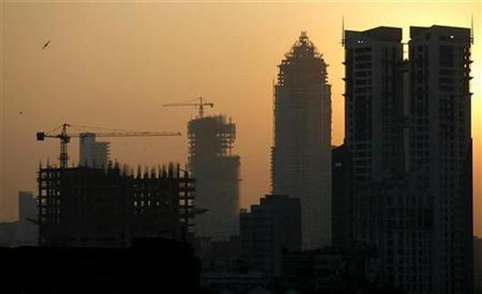Buildings under construction are seen under the Mumbai skyline