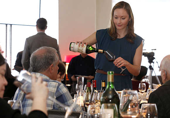 Carlee Donohue pours samples of rare wine at an auction in New York.