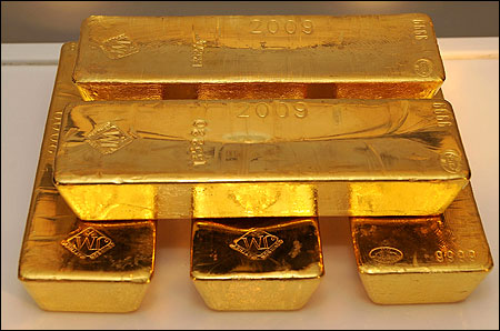 Gold bars are displayed at the GLD Fifth Anniversary Celebration in New York City.