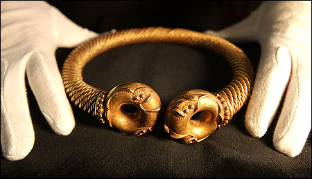 An Iron Age Torc, estimated to be as old as 50BC, made from gold and silver and valued at GBP 350,000 is on display.