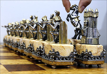 Chess of the Middle Ages exhibit, made of gold and silver, is displayed at an exhibition.