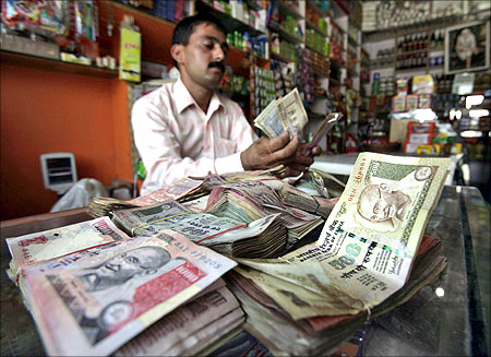 A Keeper Counts Indian Currency Notes Inside His In Jammu