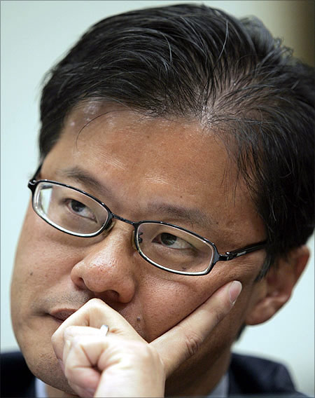Jerry Yang listens to a question during a hearing before the U.S. House Foreign Affairs Committee.