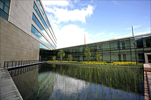 A view shows a reflecting pond along the north office building in the newly opened $500 million Bill and Melinda Gates Foundation campus in Seattle.