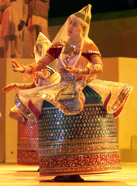 Folk dancers from Manipur in traditional attire perform in Ahmedabad.