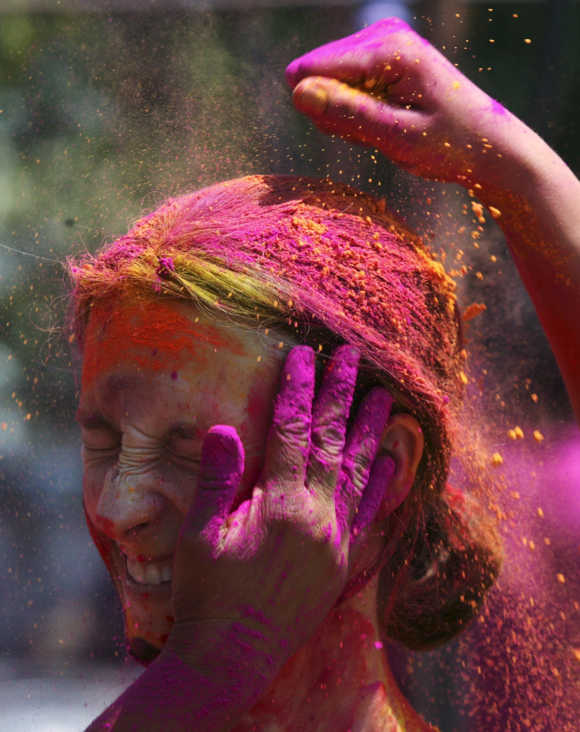 A woman celebrates Holi in Hyderabad.