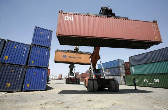 Mobile cranes prepare to stack containers at Thar Dry Port in Sanand in Gujarat.