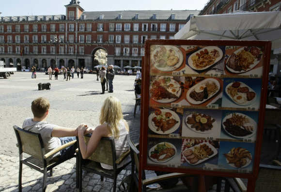 People sit in a restaurant in Madrid's central Plaza Mayor.