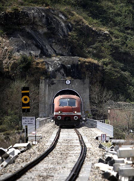 passenger train travelling the Jammu-Udhampur rail line comes out of a tunnel on the outskirts of Jammu.