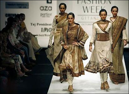 Models present creations by Indian designers Ekta and Ruchira.