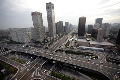 A general view of the office buildings and Guomao Bridge (bottom) in Beijing's Central Business District