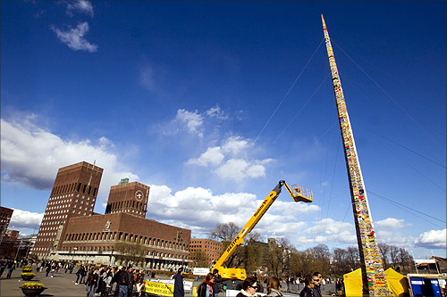 A tower created from Lego bricks is pictured completed in front of Oslo City Hall.
