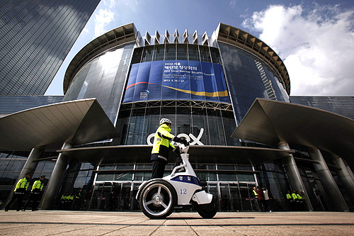 Policemen patrol in front of the COEX Convention and Exhibition Center, where the Nuclear Security Summit will be held, in Seoul.