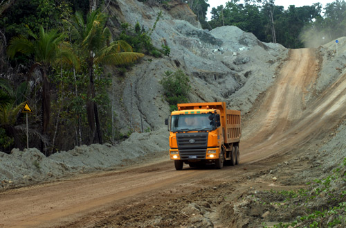 A truck takes earth containing nickel ore from a mine to a port on Halmahera island in eastern Indonesia.