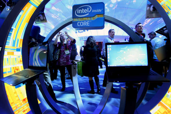 A woman takes a photo of ultrabooks at the Intel booth in Las Vegas.