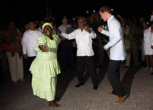 Britain's Prince Harry dances at a street party in Belmopan, Belize