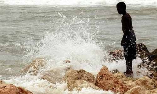 A Jamaican child plays at Hellshire beach in Kingston