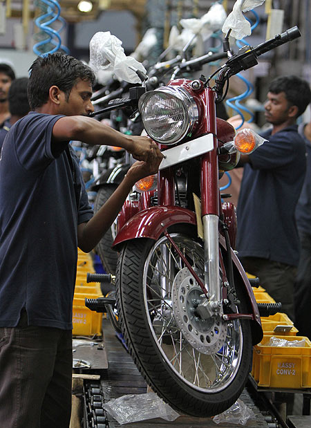 Workers assemble a Royal Enfield motorcycle inside its factory in Chennai.