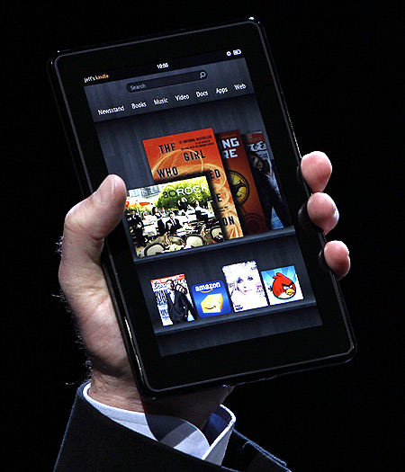 Amazon CEO Jeff Bezos holds up the new Kindle Fire at a press conference