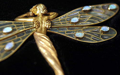 An art nouveau Spanish brooch from the 1910's, made from 18-carat gold and set with opals and worth  36,000, is displayed at Bentley and Skinner jewellers in London.