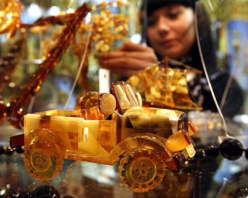 UAZ automobile exhibit, made amber and which costs about $650,000, is displayed during the Junwex Petersburg jewelry exhibition in St. Petersburg.