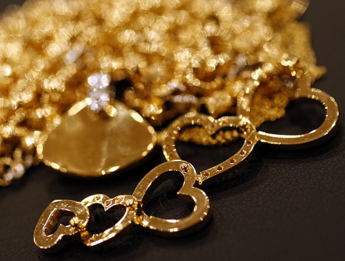 Second hand gold jewellery items are displayed at Ginza Tanaka store in Tokyo.