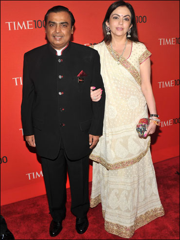 Chairman of Reliance Industries Mukesh Ambani (L) attends the TIME 100 Gala, with wife Nita.