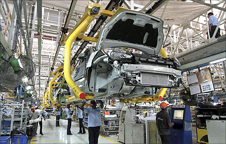 Workers assemble Ford cars at a plant of Ford India in Chengalpattu in the outskirts Chennai.