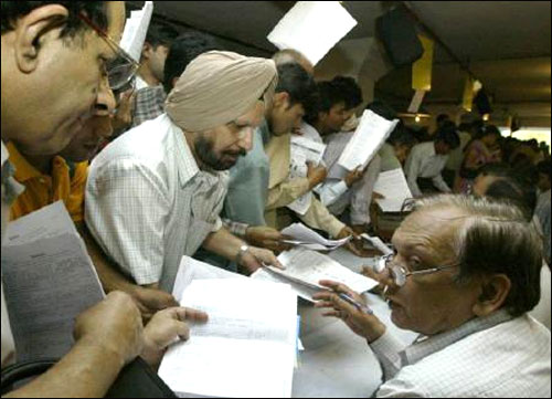 Tax payers line up to submit their income tax returns in New Delhi.