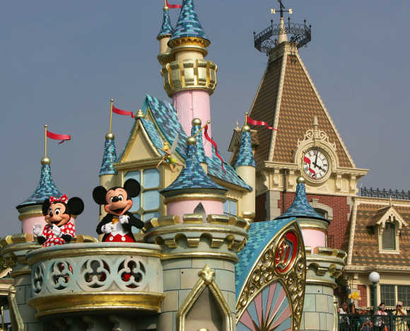 Micky Mouse and Minnie Mouse perform during 'Disney On Parade' at Hong Kong Disneyland.