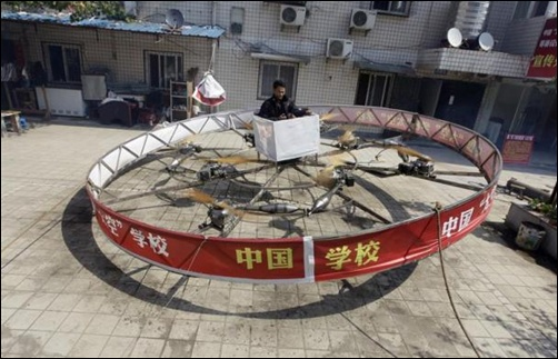 Local farmer Shu Mansheng hovers above the ground in his self-designed and homemade flying device during a test flight in front of his house in Dashu village on the outskirts of Wuhan, Hubei province, China.