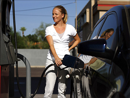 A motorist pumps fuel into her vehicle at JJ's Express Gas Plus station in Phoenix gas station in Phoenix, Arizona.