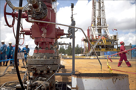 Crude oil drips from a valve at an oil well operated by Venezuela's state oil company PDVSA in Morichal.