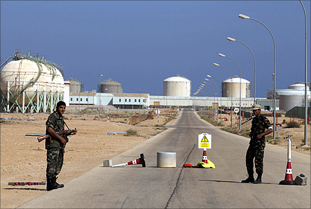 Armed National Transitional Council (NTC) fighters stand at a checkpoint at the Libyan Oil Refining Company (LERCO) in Ras Lanuf.